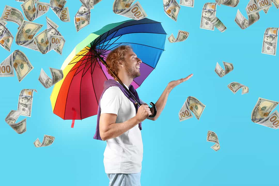 Man with rainbow umbrella on color background